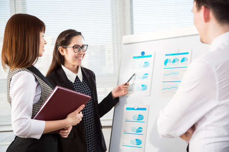 Group of happy businesspeople in a meeting at office Stock Photo