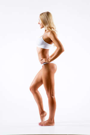 Beautiful fitness woman with a perfect body Stock Photo
