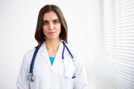 Portrait of happy successful female doctor
