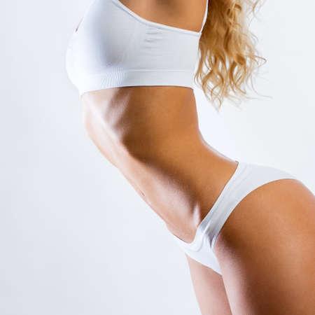 Slim woman shows her beautiful body