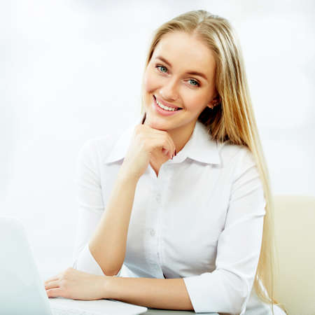 Young business woman with notebook in the office