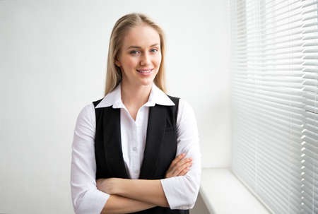 Portrait of a business woman against a window.