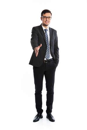Young smiling businessman welcomes you Banco de Imagens
