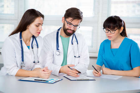 Group of doctors in the clinic discuss the diagnosis of the patient Stok Fotoğraf
