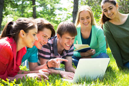 Group of students studying together in campus ground 스톡 콘텐츠