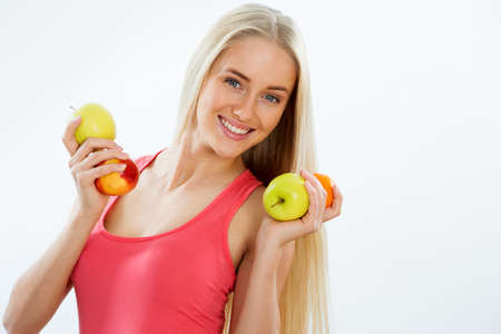Smiling pretty woman with fruit Stock Photo