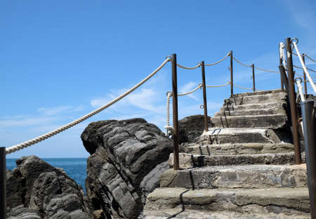 Beautiful landscape with an ancient staircase amidst stones by the sea