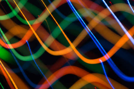 Abstract picture of bright colored dynamic lights on a dark background Stock Photo