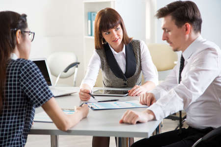 Young business people discussing a new project at a meeting in the office Stock Photo