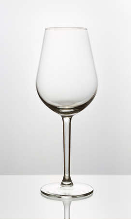Elegant empty glass of wine on a white background