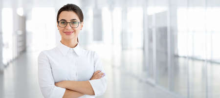 Young beautiful business woman in an office Stockfoto