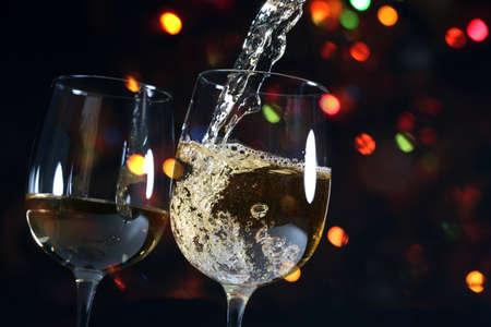 Beautiful splash of wine in a glass on a dark background
