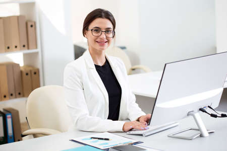 Young beautiful business woman with computer in an office Standard-Bild