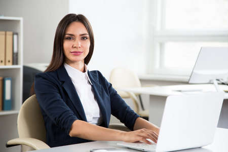 Portrait of businesswoman working with computer in an office