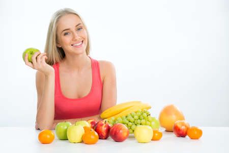 Young smiling pretty woman with fruits