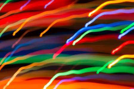 Abstract picture of bright colored dynamic lights on a dark background Zdjęcie Seryjne
