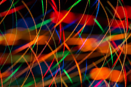 Abstract image of bright colored dynamic lights on a dark background