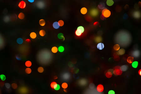 Christmas background of blurred lights with decorated tree