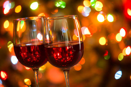 Crystal glasses of wine on the background of Christmas lights Stock fotó - 133410759