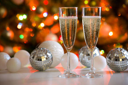 Two champagne glasses and christmas balls on the background Stock Photo