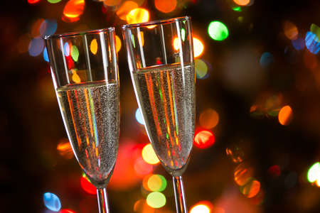 Champagne glasses on the background of Christmas lights Stock Photo