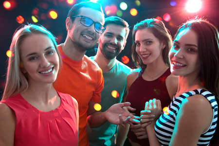 Group of happy young people having fun at party. Imagens
