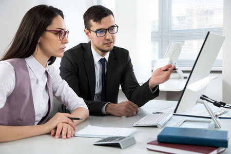 Businessman explains to colleague a new project in the modern office 版權商用圖片