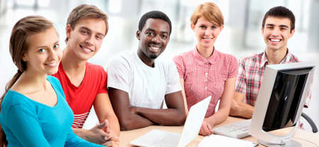 International group of students studying together in a university