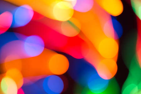 Abstract picture of bright colored dynamic lights on a dark background Фото со стока