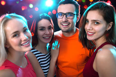 Group of happy young people having fun at party.
