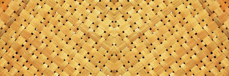 Bamboo woven textured, detail handcraft bamboo weaving texture backgrounds, with yellowed colors natural. applicable backgrounds banner, wallpaper, and backdrops printing media surface.