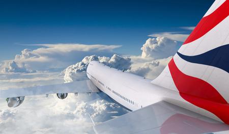Boeing 747  flying in the clouds. Foto de archivo