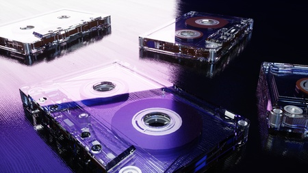 Audio cassettes on the blue wooden surface. Retro music concept. 3d rendering.