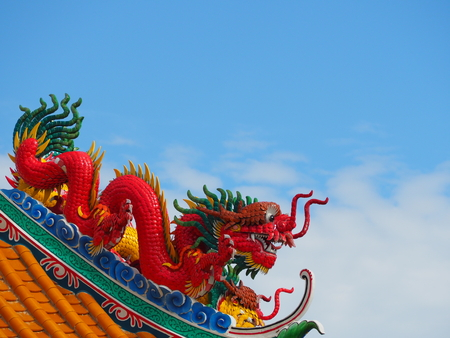 Colorful dragon statue background is sky.