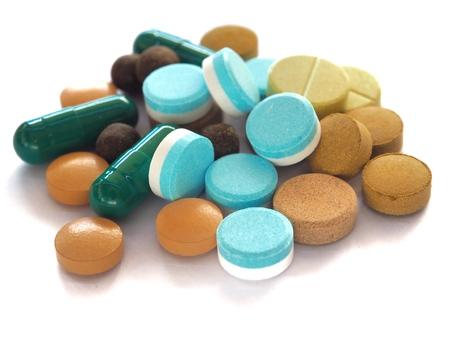 Een veelkleurig medicijn op een witte achtergrond Stockfoto