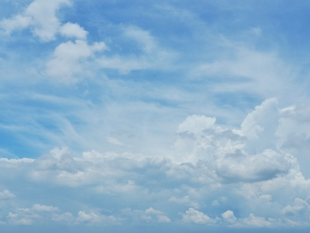 Blue sky and white clouds. It is beautiful and bright in summer. The moment of happiness and freedom is heaven.