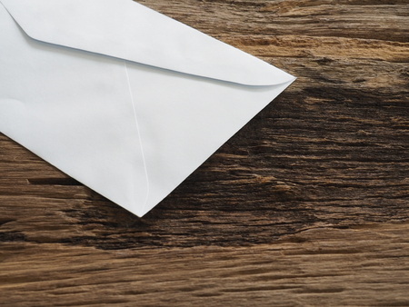 White envelope on old table In the business concept. Meaning, Resignation or Leave