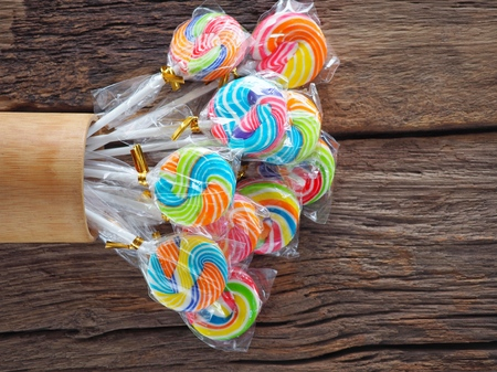 Colorful lollipop on the wooden board in the children's fun concept, joy, cheerfulness, happiness