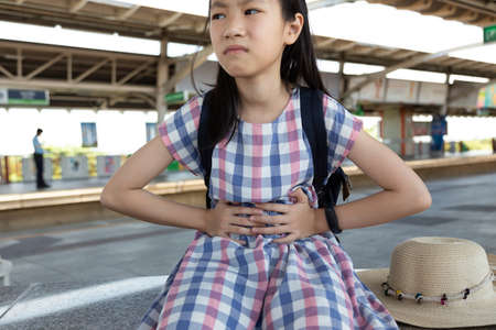 Asian girl suffering from stomachache,health care problem