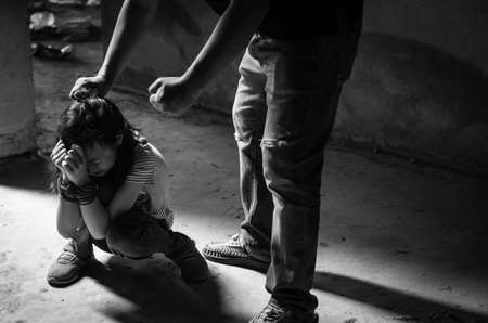 Asian girl with his hands tied in an abandoned building,stop abusing violence,human trafficking concept Banco de Imagens - 110247282