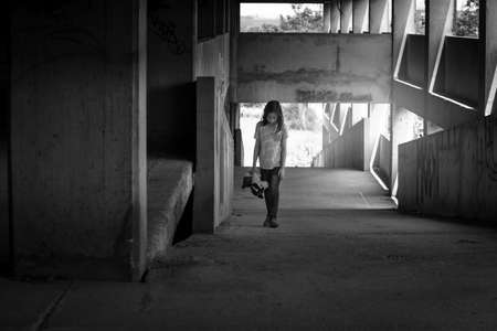 Depressed young girl walking alone in an abandoned building,Children with Behavioral and Emotional Disorders