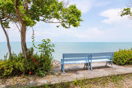 Rest area,seaside car break point,view point with chair,relaxation sitting on bench looking out into the open sea surrounded by nature and blue sky background on Koh Chang,Trat,Thailand
