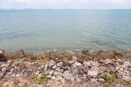 Coastal protection,waves breaking on a rocky breakwater at the beach in Koh Chang,Trat,Thailand