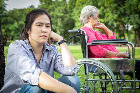 Asian woman feel offended,slighted with elderly people not talking after senior mother argument,argue with daughter in outdoor park,relationship difficulties,conflict,family problems concept