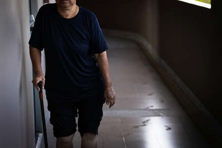 Asian old elderly people wet all over body after a heavy rain in the rainy season,feel fever,sad senior woman got soaking wet while walking home in the rain,cold and flu season, health care concept
