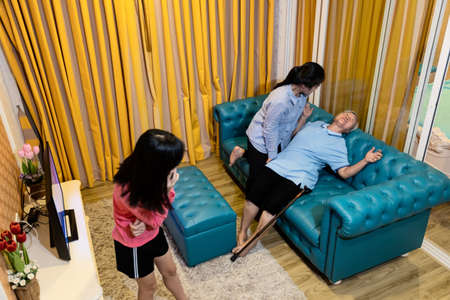Sick senior with epileptic seizures at home,female patient suffer from seizures,illness with epilepsy during seizure attack,asian daughter help,care of elderly mother,concept of brain,nervous system Standard-Bild - 134653498