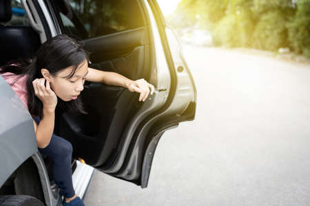 Unhappy asian child girl about to throw up from car sick or indigestion,female teenage vomiting in a car suffers from motion sickness or food poisoning,sad woman feel dizzy and nauseous from carsick Zdjęcie Seryjne