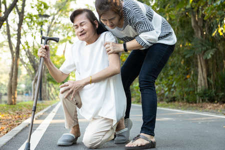 Sad asian senior woman suffering arthrites, knee osteoarthritis knee pain,legs or muscles weak while walking,stumbling and falling down, elderly people had an accident,knees fell and hit the ground