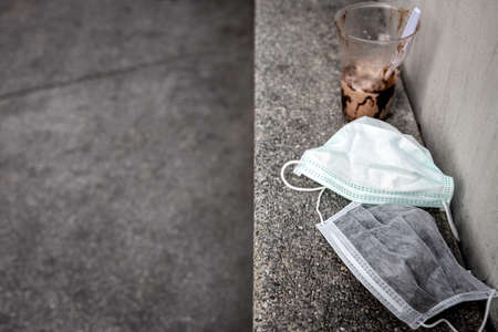 Litter of plastic and hygienic mask prevent the Corona virus, coronavirus 2019-nCoV,Influenza virus,hazardous waste,infectious waste,risk of disease,spread of germ, throw trash in trash can