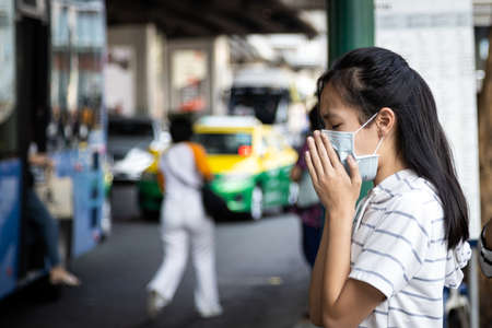 Asian child girl suffer from cough,sneeze with protection mask,sick woman wearing medical mask to prevent air pollution in the city,girl with face mask,concept of pollution,dust allergies,bad health